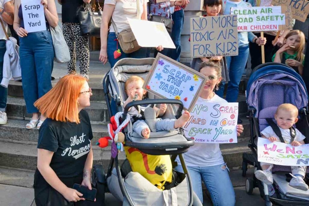 children and parents with protest placards