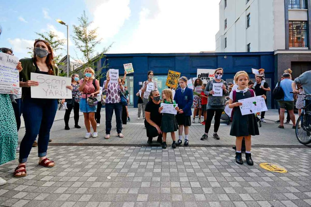 protesters with children and placards