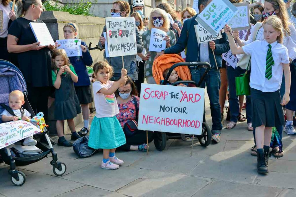 children with placards in street protest