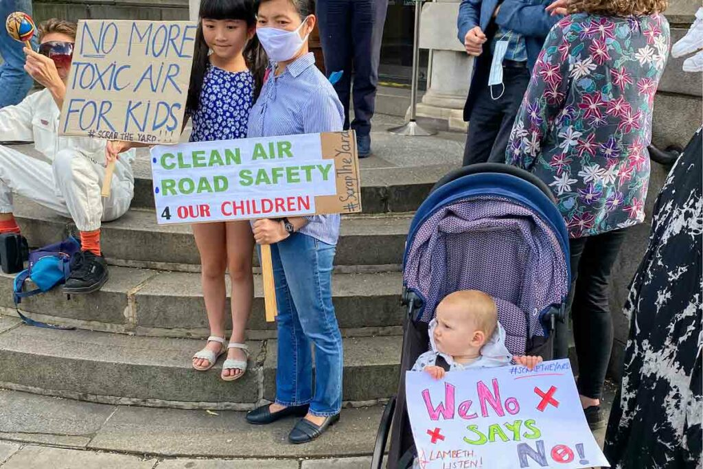 children with protest placards