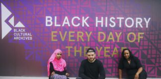 people in front of a wall sign