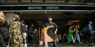 poet with placard outside startion