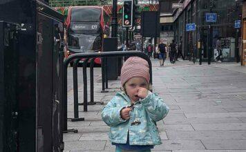 girl holding nose