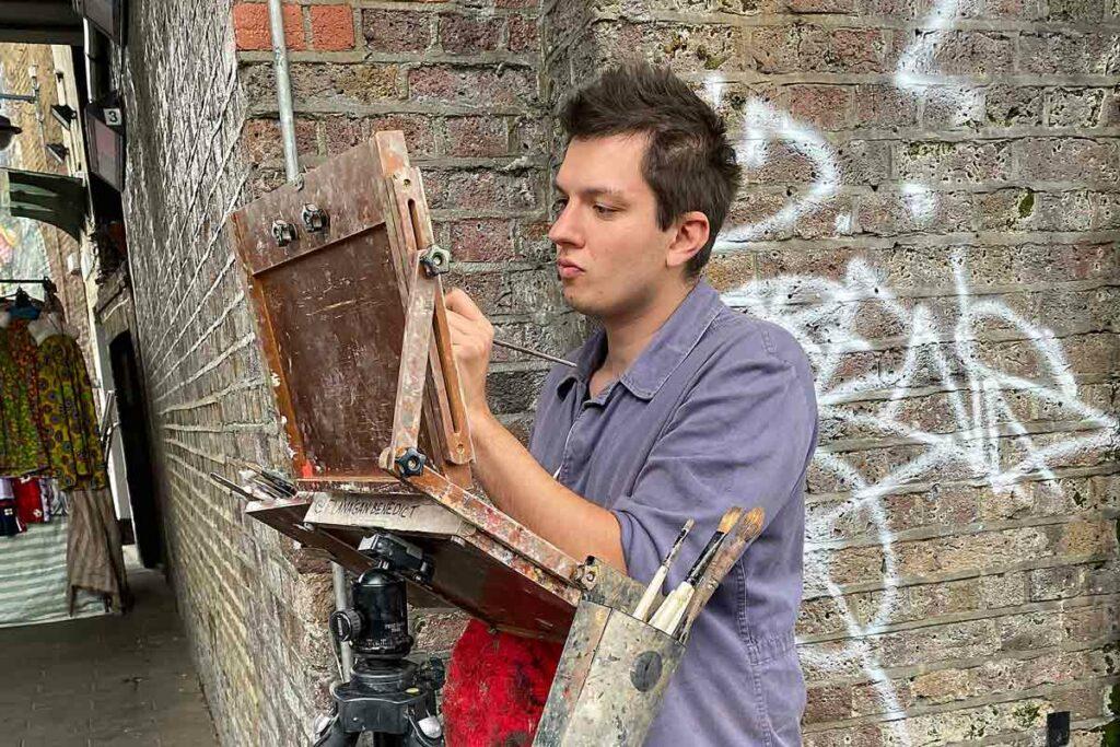 artist at work in urban street