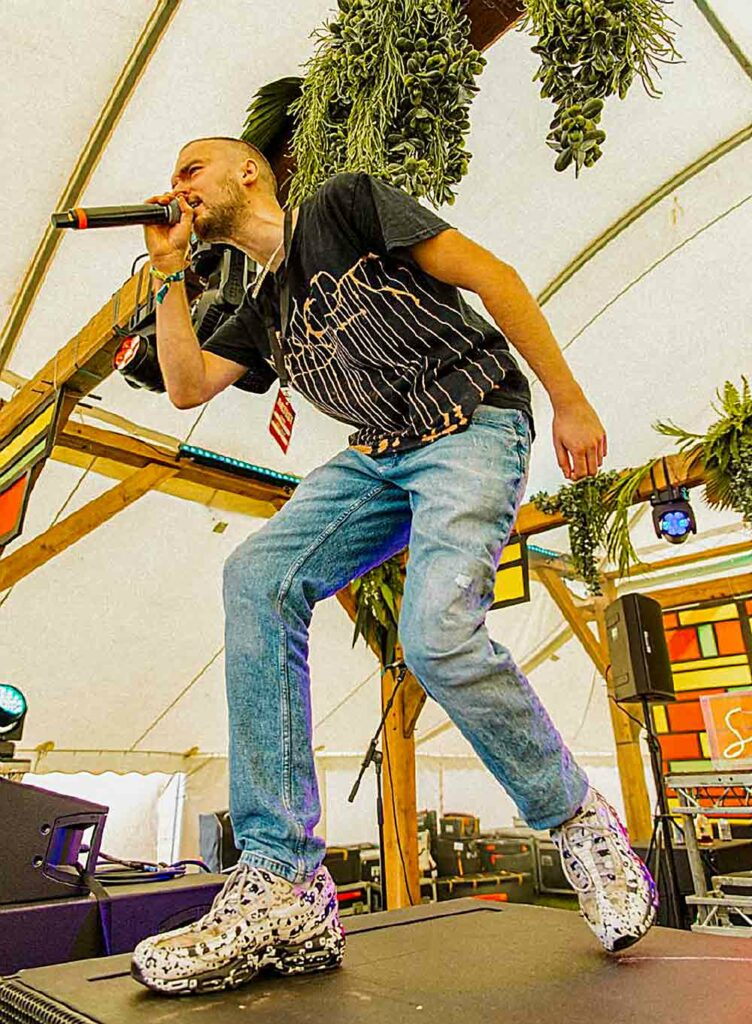 male singe performs at open air festival