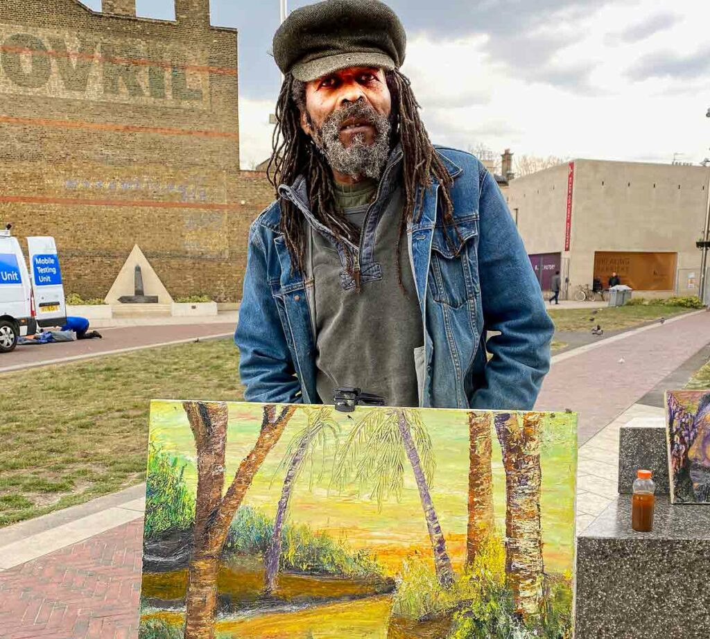 artist with qorl in open air