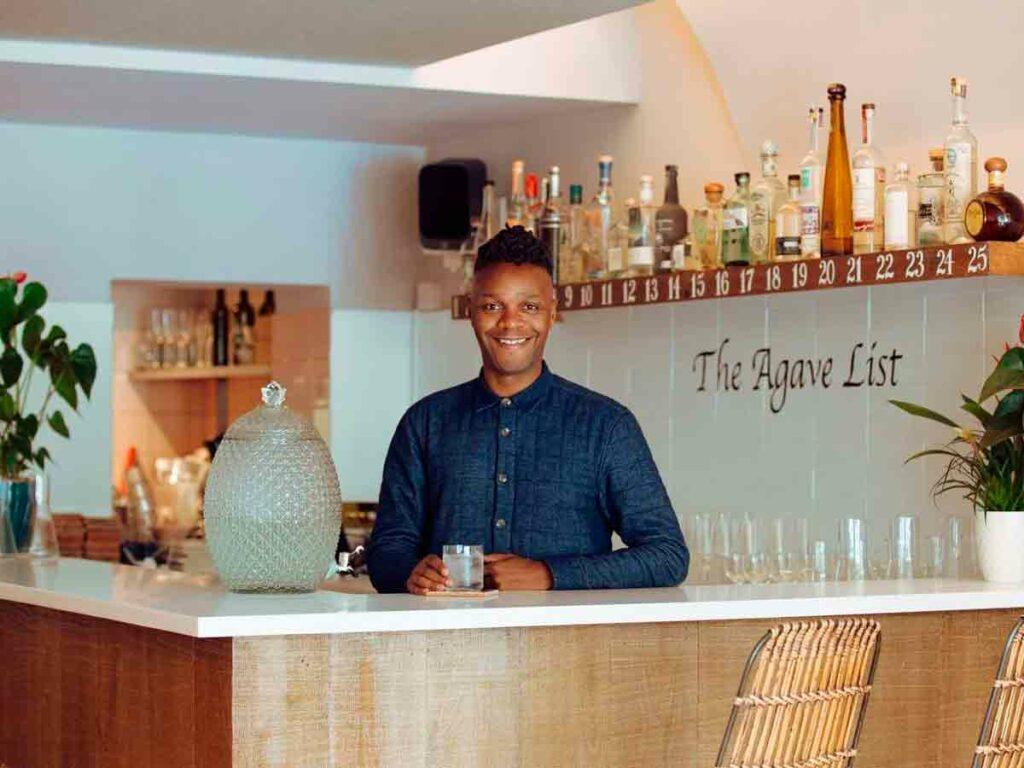 man behind bar