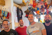 four men in shop