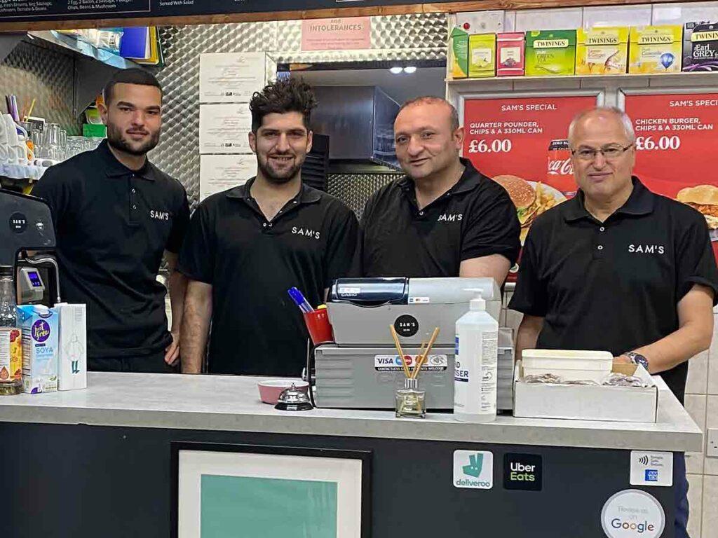 men behind cafe counter