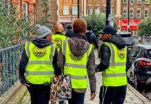 school patrol volunteers in branded tabards