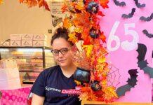 woman at door of cake shop